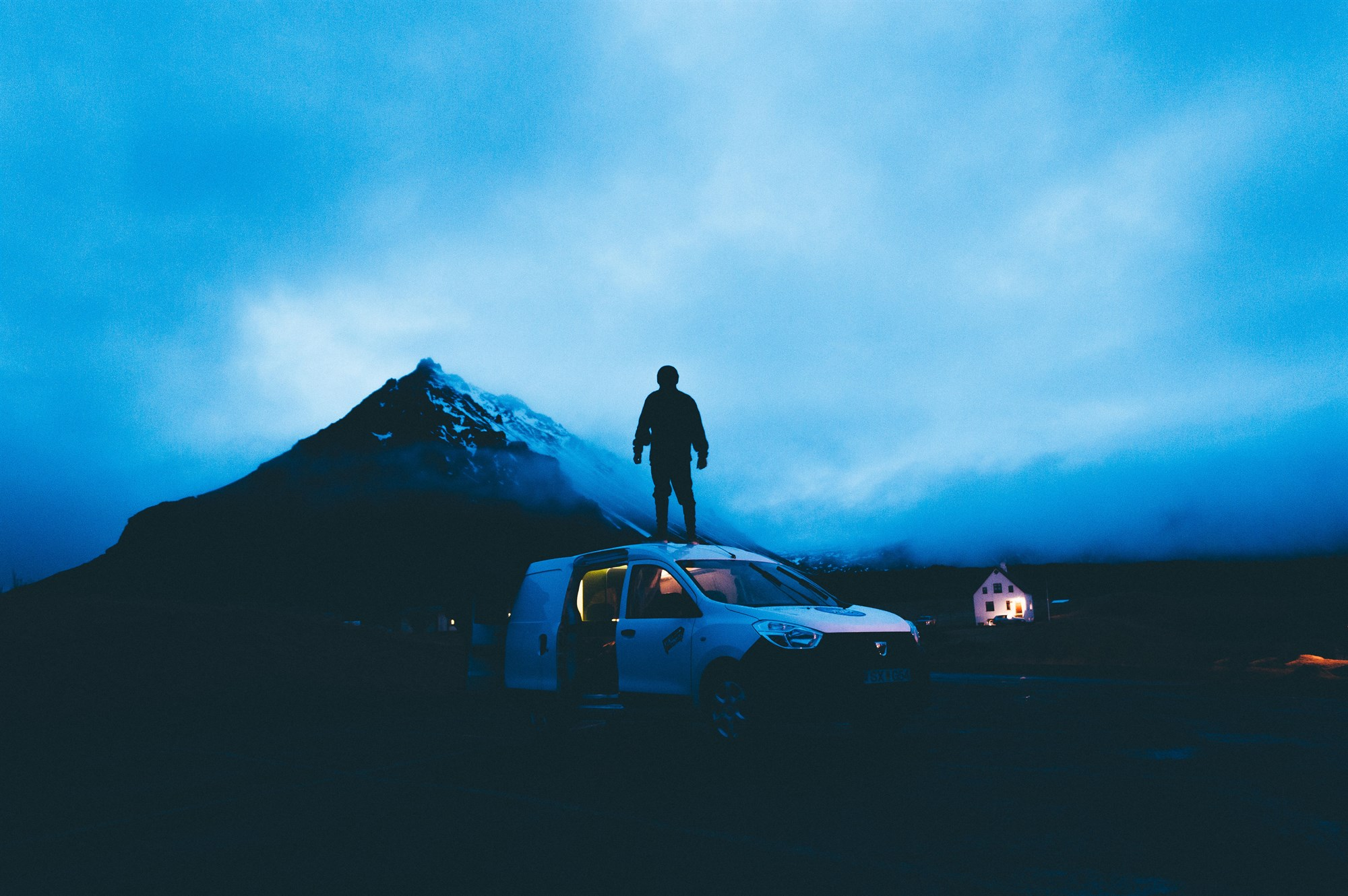 Man standing on a car in Iceland