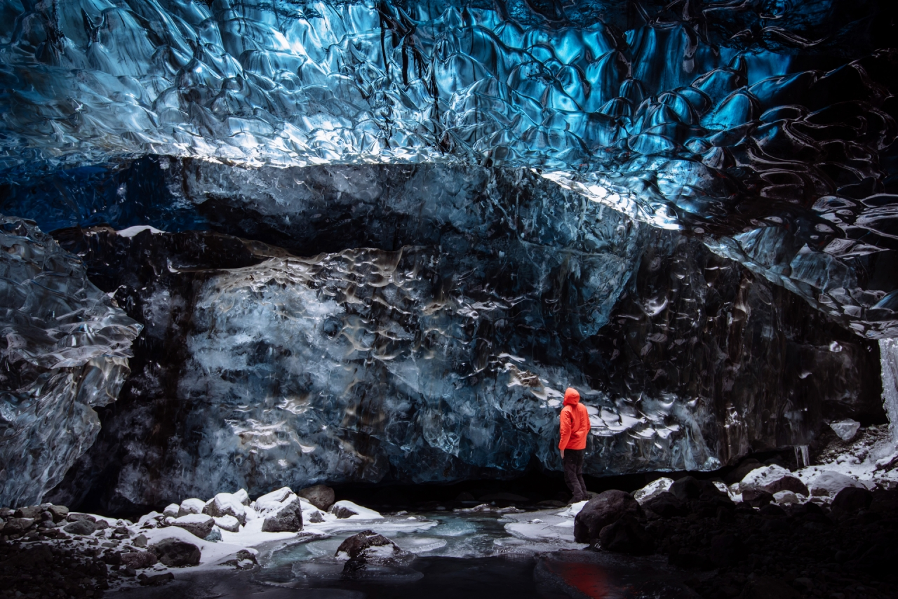 Man standing in the ice cave in Iceland