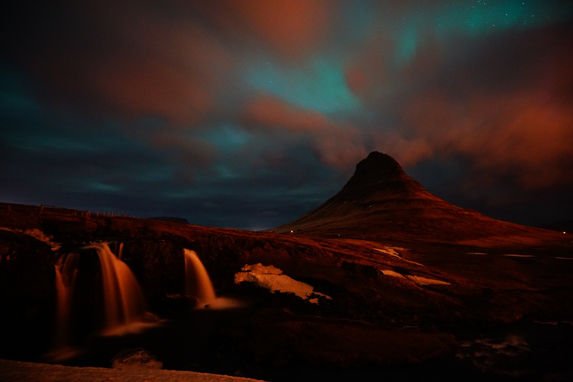 Kirjkjufell in iceland with blue northern lights