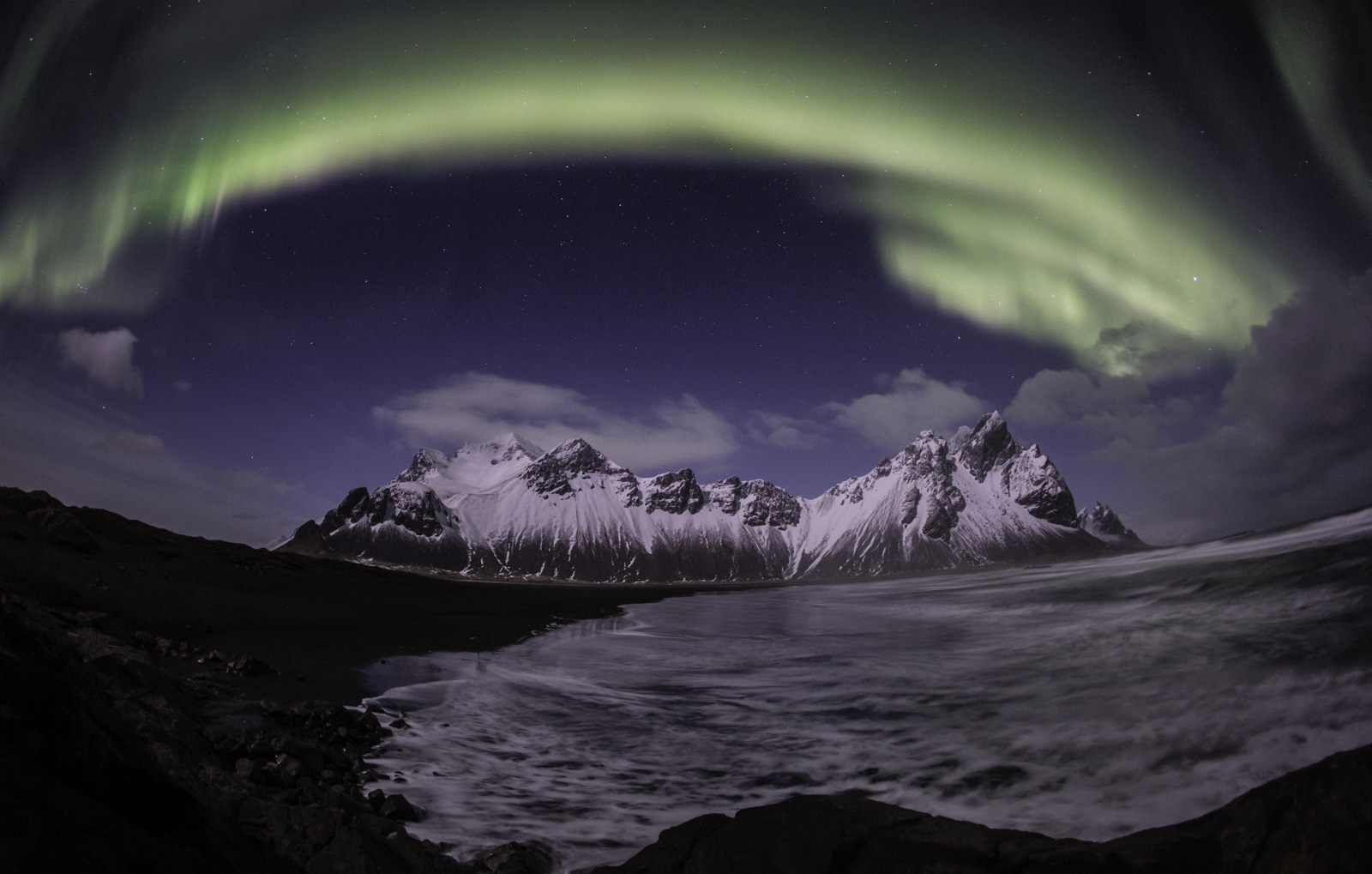 Northern lights in Iceland over mountains