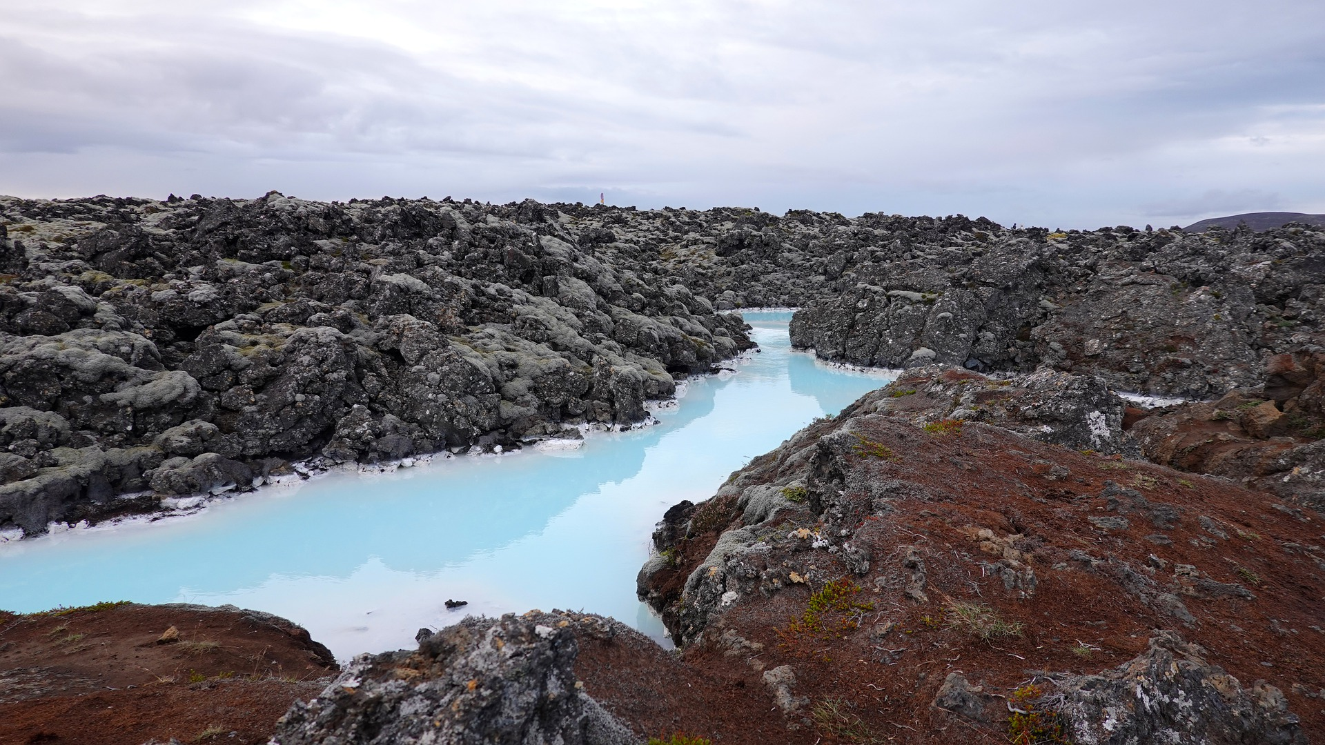 blue lagoon iceland, milky blue water and rocks
